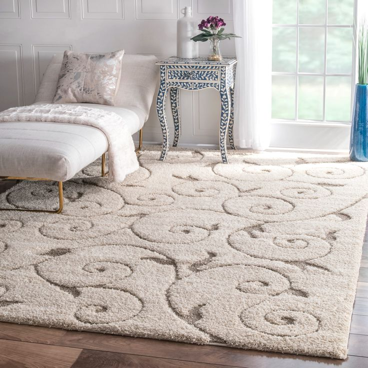 The intricate vine pattern of this ivory shag rug will enhance any room's decor. It's made from synthetic fiber with a low pile to make it soft and easy to maintain, and because of its subtle colors it easily goes with a myriad of schemes.