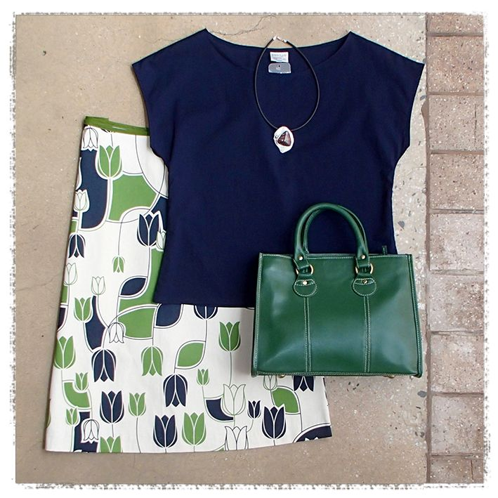 Crisp lines & a bold print by Essaye keep it simple & cool with a smart Leather Cargo handbag & MeyeArt necklace