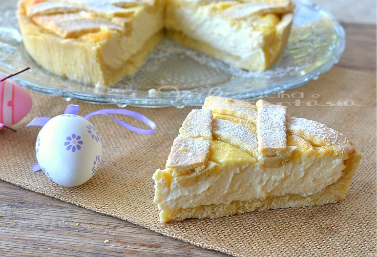 Crostata di ricotta ricetta dolce una pasta frolla friabile ed un ripieno di ricotta bianca profumata con fiori d' arancia, limone e vaniglia