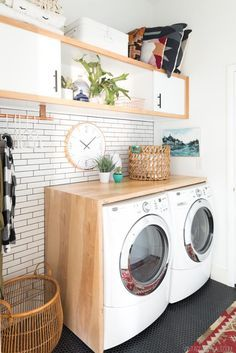 Update your laundry room by using plywood to build a waterfall countertop that goes over your washer and dryer and wraps around the side. By using affordable materials the countertop can be left plain or painted to any color and adds plenty of additional counter space to your laundry room for folding laundry or storing laundry baskets!