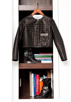 Marisa Klass' Prada jacket and IXOS booties on bookshelf
