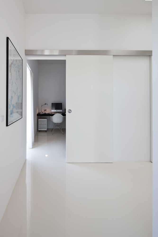 I love the white sliding doors to the work space.