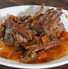 Pot roast with wine.Beef rump roast with vegetables and dry red wine cooked in Dutch oven.