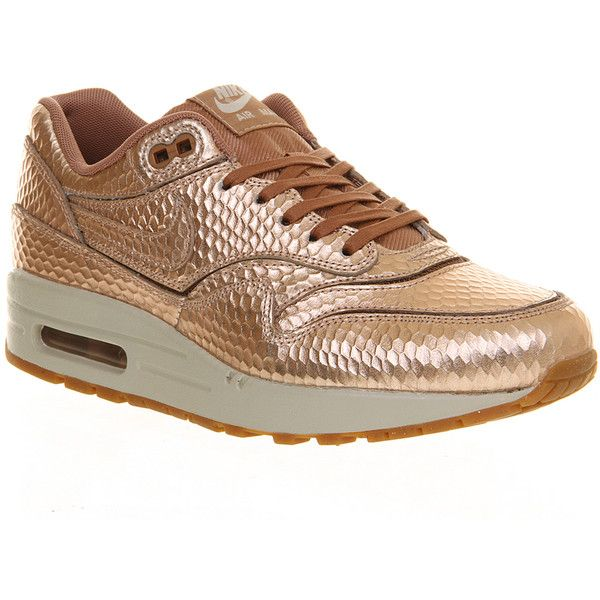 Nike Air Max 1 (270 BRL) ❤ liked on Polyvore featuring shoes, athletic shoes, nike, sneakers, hers trainers, metallic bronze cut out, trainers, metallic shoes, cutout shoes and nike shoes