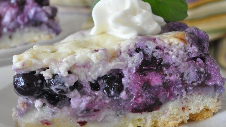 I went to a potluck and someone brought this dessert. A dense cake layer is topped with a rich blueberry and sour cream layer. This dessert is awesome! Serve with whipped cream and enjoy!