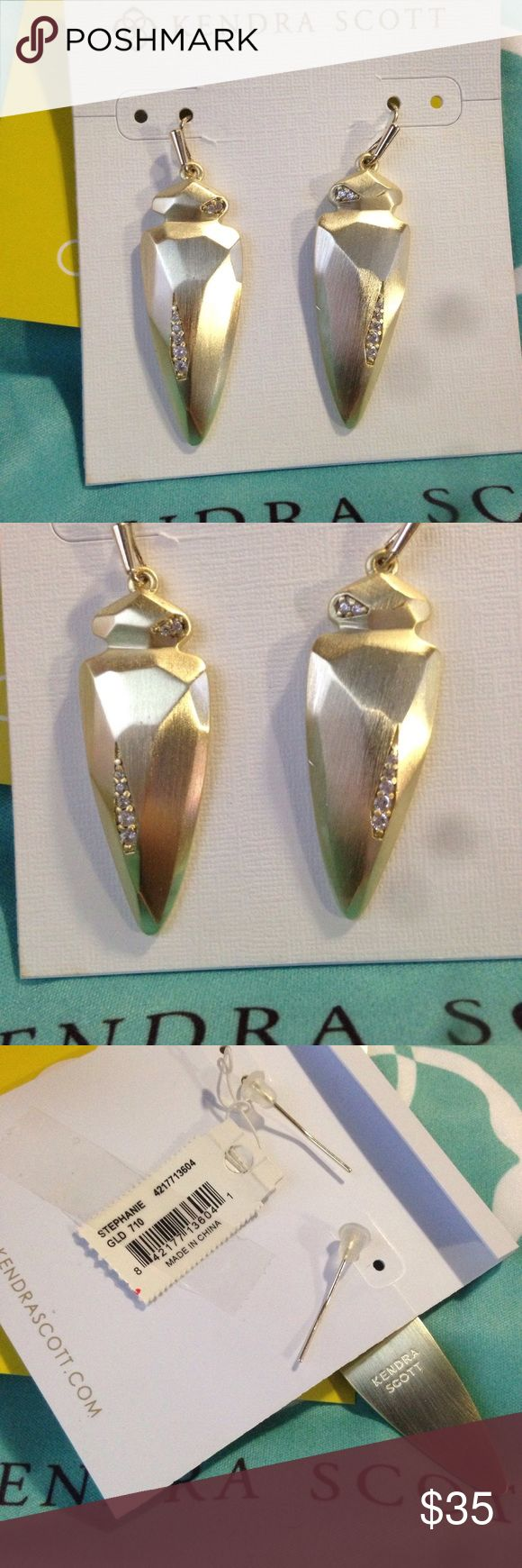 Kendra Scott Stephanie YG Brand new Stephanie earrings in brushed Yellow Gold with crystal accents by Kendra Scott. Display card, care card, dustbag bag, silicone backs, and tags included. Priced for quick sale!  NOTE: solid metal, not hollow, slightly heavier than an Elle; two small flaws (scratches) on second earring, see last pic.  ✅ offєɾѕ ✅ вυndlєѕ ✅ tɾαdєѕ ✅ cɾoѕѕ-ρoѕтєd ❌ ραყραl Kendra Scott Jewelry Earrings