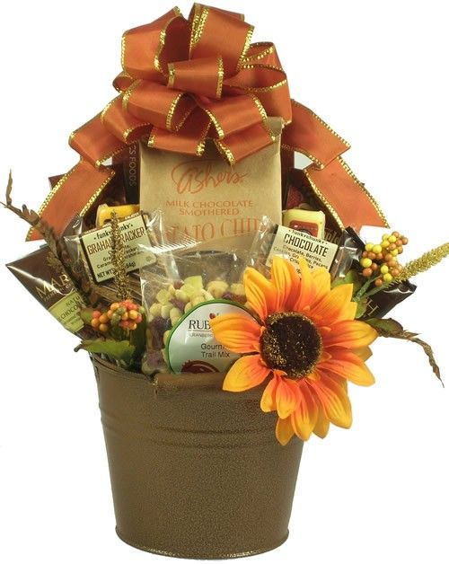 Rich, warm and inviting colors make up this unique and charming Fall Gift Basket that's perfectly named the Rustic Charm Gourmet Fall Gift Basket. Our Rustic Charm Gourmet Fall Gift Basket has an incredibly delicious selection of gourmet goodies loaded inside of a rustic keepsake planter.  $72.99  http://www.littlegiftbasketboutique.com/item_1179/Rustic-Charm-Gourmet-Fall-Gift-Basket.htm