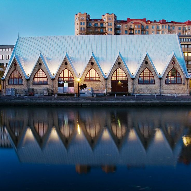 Feskekôrka fish market hall, Gothenburg Sweden │ The market hall for fish and shellfish is a characteristic building from 1874, with a church-like design. The market has several fishmongers and restaurants. Buy some take away-shrimps and sit by the canal or try Restaurant Gabriel upstairs. │ Photo: Kjell Holmner