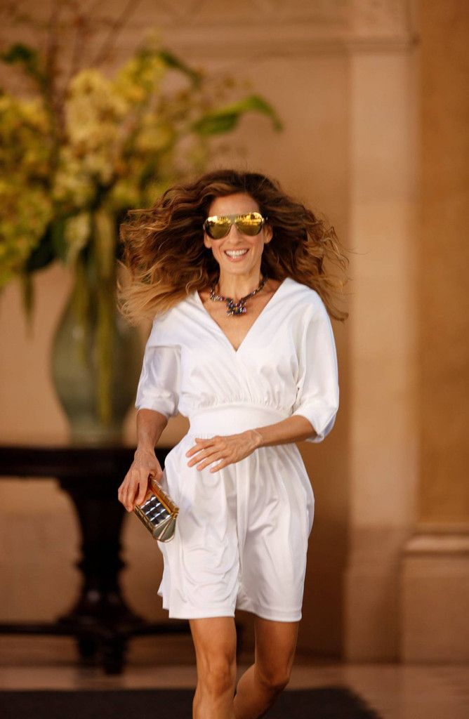 Sarah Jessica Parker Metallic Clutch - SJP's studded metallic clutch goes perfectly with her shades.