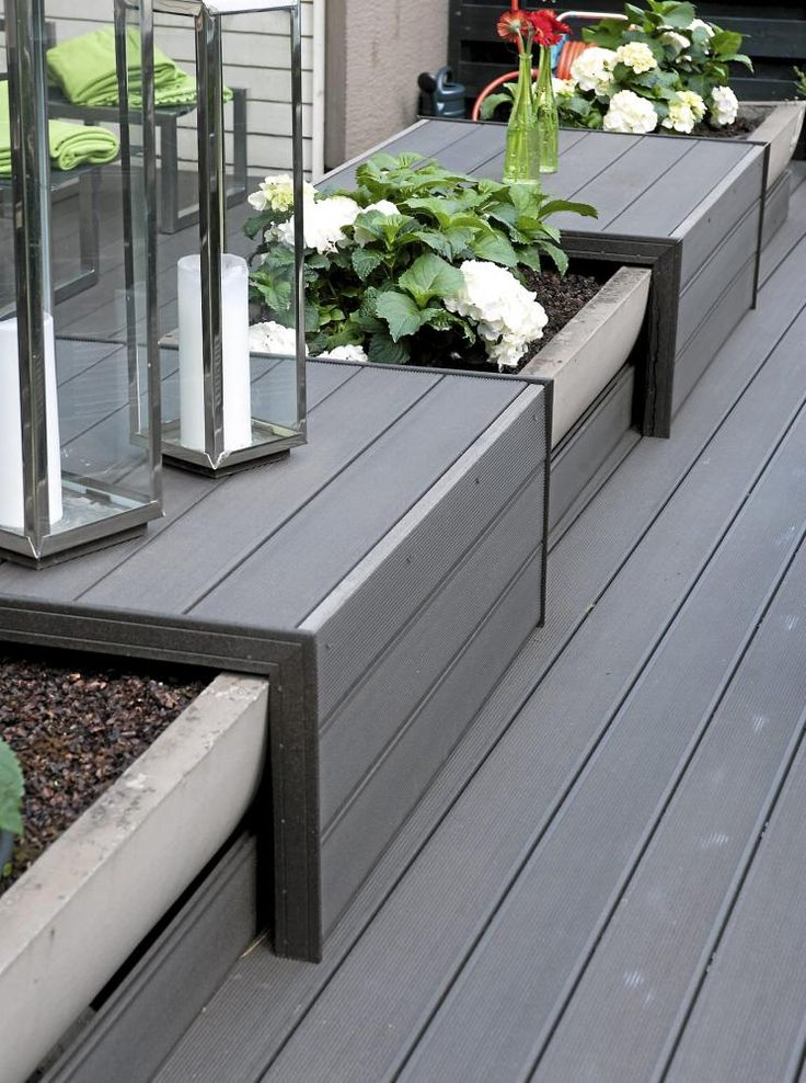 Great use of deck space. The built- in planters soften the deck area.