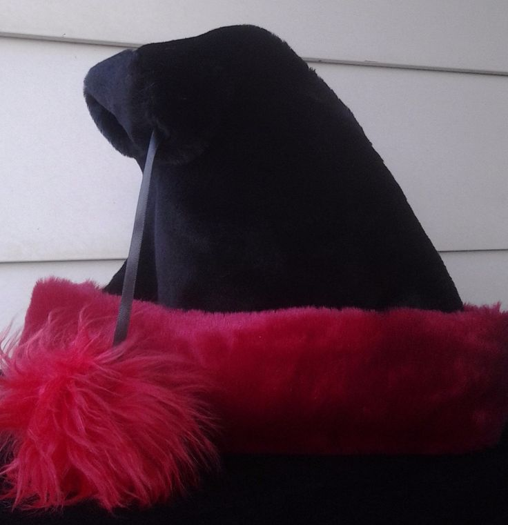 Black Santa hat with red trim and fluffy red ball by OriginalsByEva on Etsy