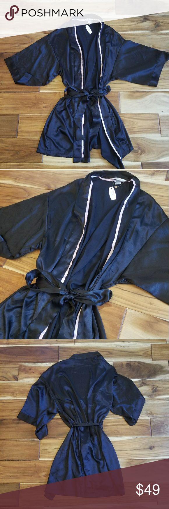 NWT Victoria's Secret Satin Kimono Robe NWT Victoria's Secret Satin Kimono Robe. New, never worn! Size small/medium. Beautiful black satin robe trimmed with pink. No trades, offers welcome.  Enjoy! Victoria's Secret Intimates & Sleepwear Robes