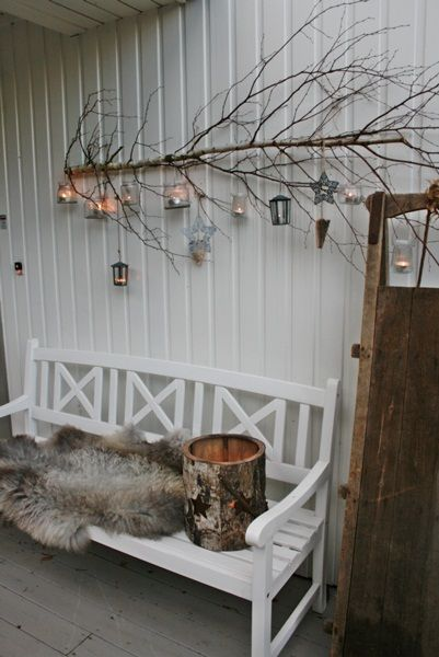 Love this side ways branch hung with lights and ornaments!