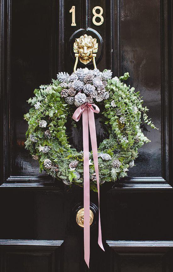 beautiful black door and wreath