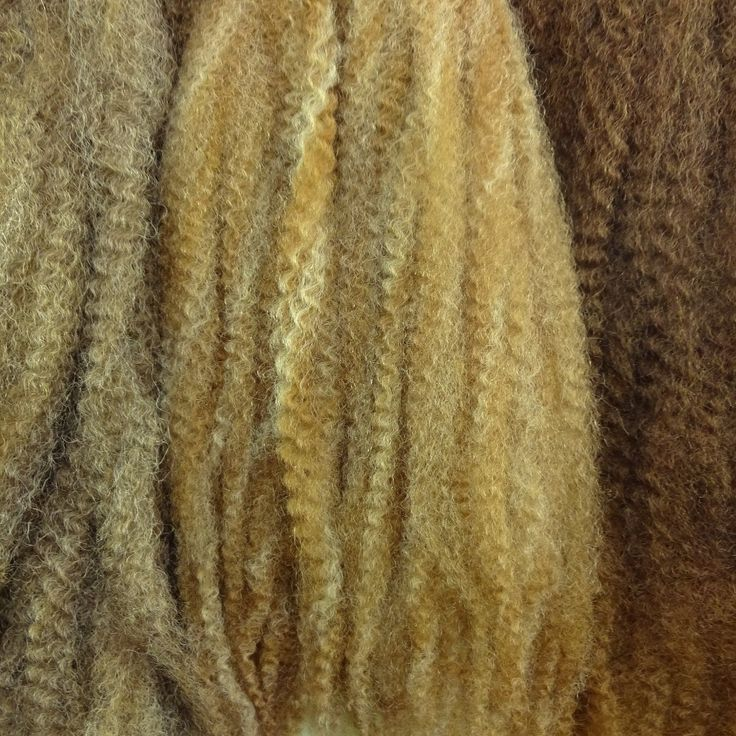 Color comparison from left to right: Seashore dreadlock braid, 27/613 Mixed Blond marley braid, Peanut Butter Cup dreadlock braid