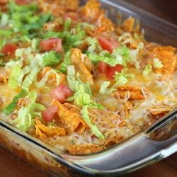 preheat oven 350.  mix 2c shredded chicken, 2c shredded cheese, can of cream of chicken, 1/2c milk, 1/2c sour cream, can of drained rotel, & 1/2 pack taco seasoning.  Grease casserole dish.  Crush 1/2 bag doritos and place in bottom, top with mixture, crush a few Doritos on top.  Bake for 30 minutes.  Garnish with lettuce and tomato.