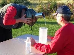 Family reunion games. Glue a old can to a bike helmet.