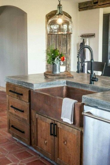 Love the concrete countertops, copper farmhouse sink, and rustic woods: