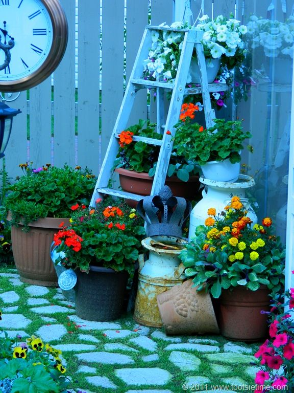 ladder and milk can in outside garden.... getting ready to paint my ladder....doing something like this in the backyard....