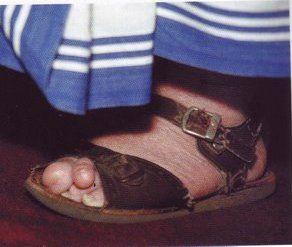 feet of Mother Teresa.