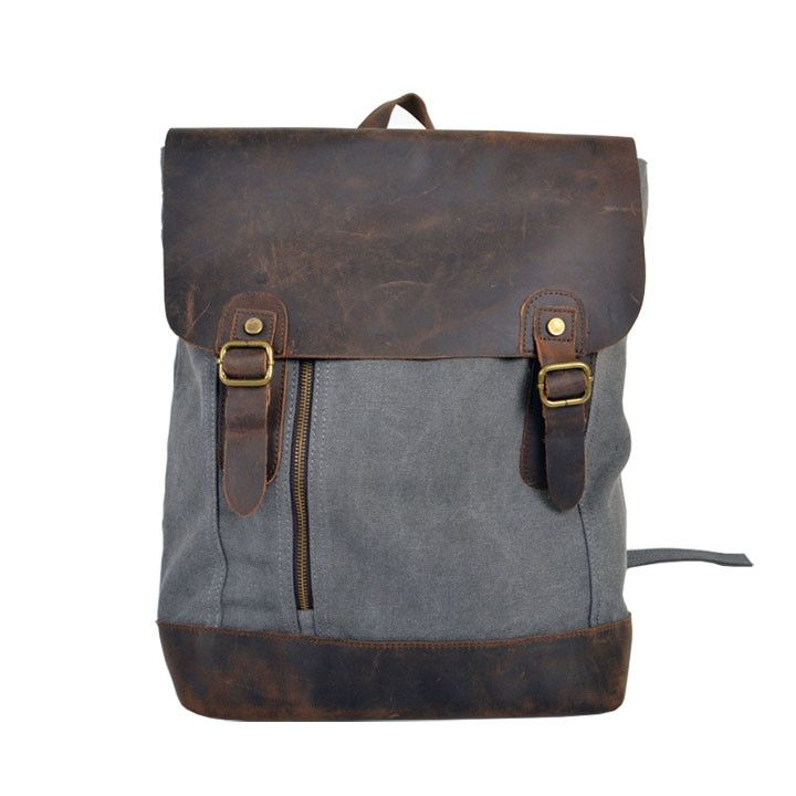 Features: • Canvas & leather • One large pocket • Four interior pockets • One small exterior pocket • Color: grey • Measurements: 45cm x 30cm x 15cm Fabric & Care: • 100% cotton canvas • Hand wash • I