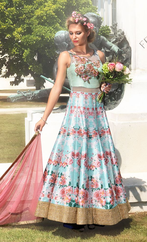 Floral Print Anarkali Arctic blue floral anarkali suit in raw silk teamed up with a rose coloured dupatta in net fabric.