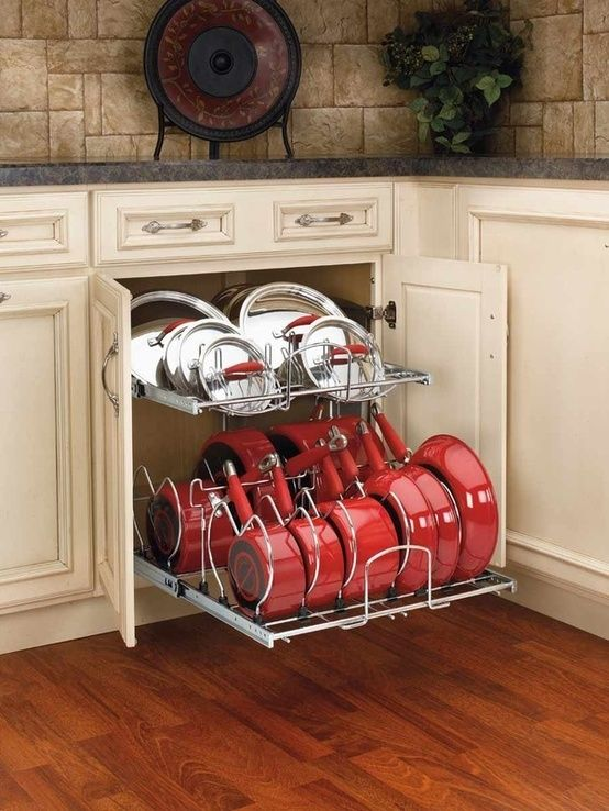 This is how pots and pans should be stored. Lowe's and Home depot sell these. Sweet!