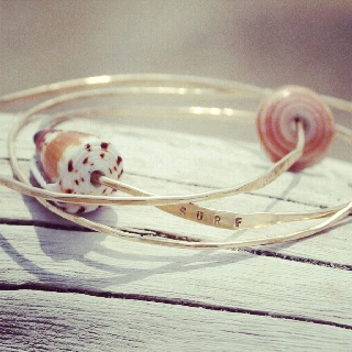 Surf seashell bangles in gold