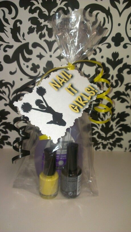 Cheer/party gift for girls. Nail polish nail ploish remover and a gift tag that says NAIL IT GIRLS.