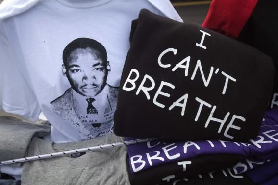 T-shirts with the image of Martin Luther King Tributes, protests mark U.S. Martin Luther King Jr. Day.  REUTERS-Carlo Allegri