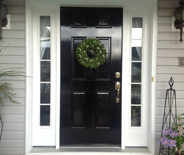Black gloss door, white trim, light gray siding and maybe a darker stone