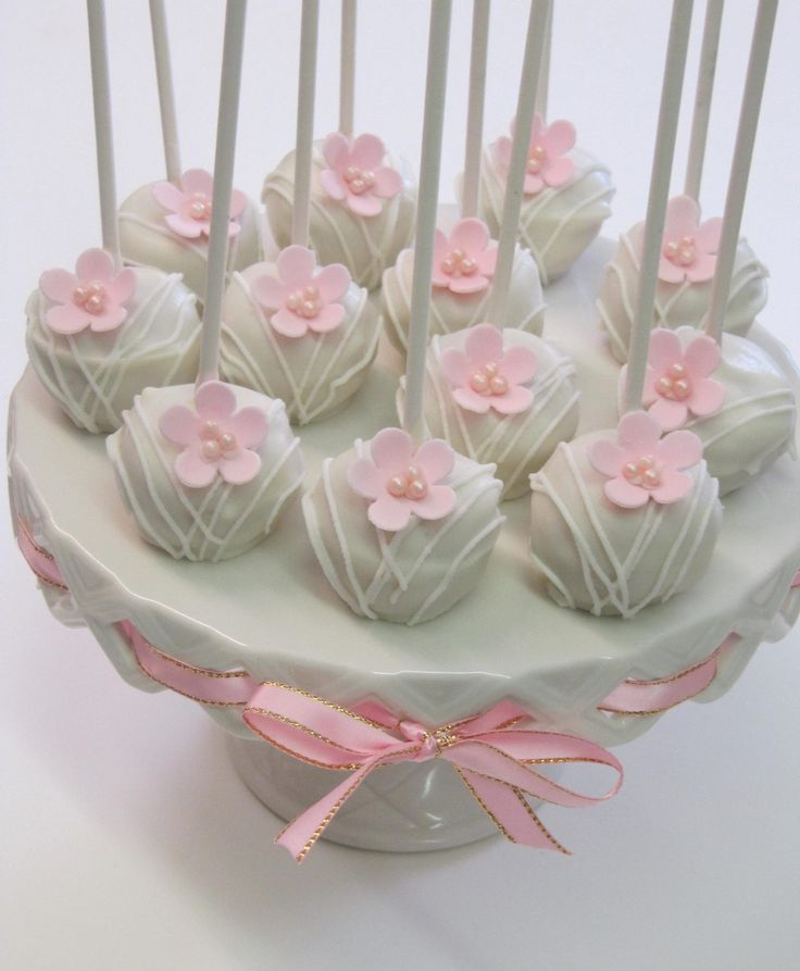 White cake pops with fondant flower and sugar pearls.  Perfect for weddings and showers