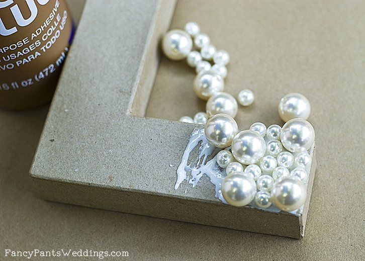 cardboard letters with pearls in different sizes glued to them could be a pretty cool decoration for a dorm room or it could make a gorgeous prop for a