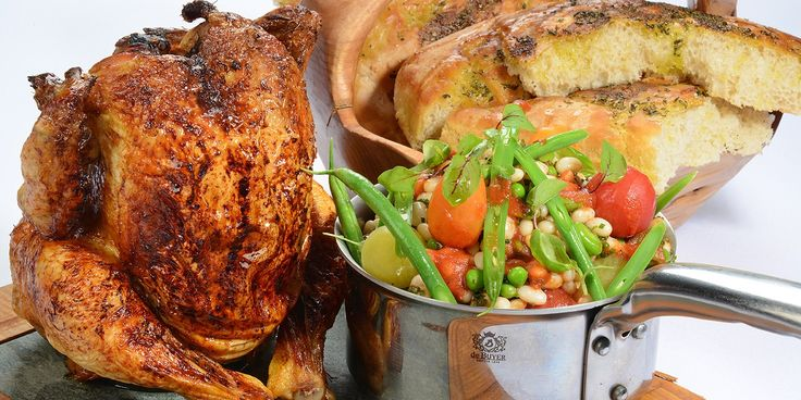 The ultimate summer barbecue chicken recipe from Lisa Allen, beer can chicken served with summer beans and a garlic bread recipe.