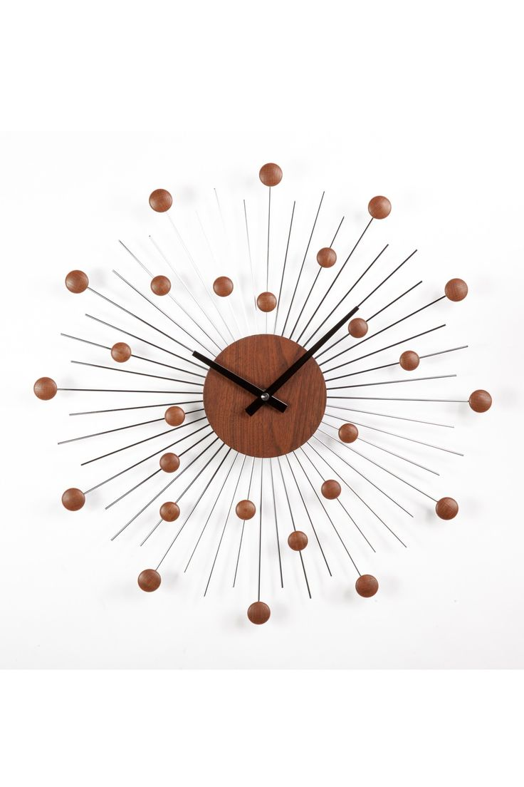 The Telechron mid-century Star clock is a stunning addition to any modern  decor. It features a solid wood core and wooden mini balls which are  randomly ...