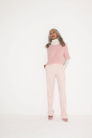 white polo neck pale pink trousers pink court shoes