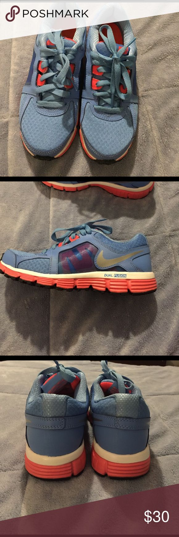 Nike Dual Fusion ST2 sneakers Only worn a few times. Clean and in good condition. Very comfortable and light weight. Light blue with pink. Nike Shoes Sneakers