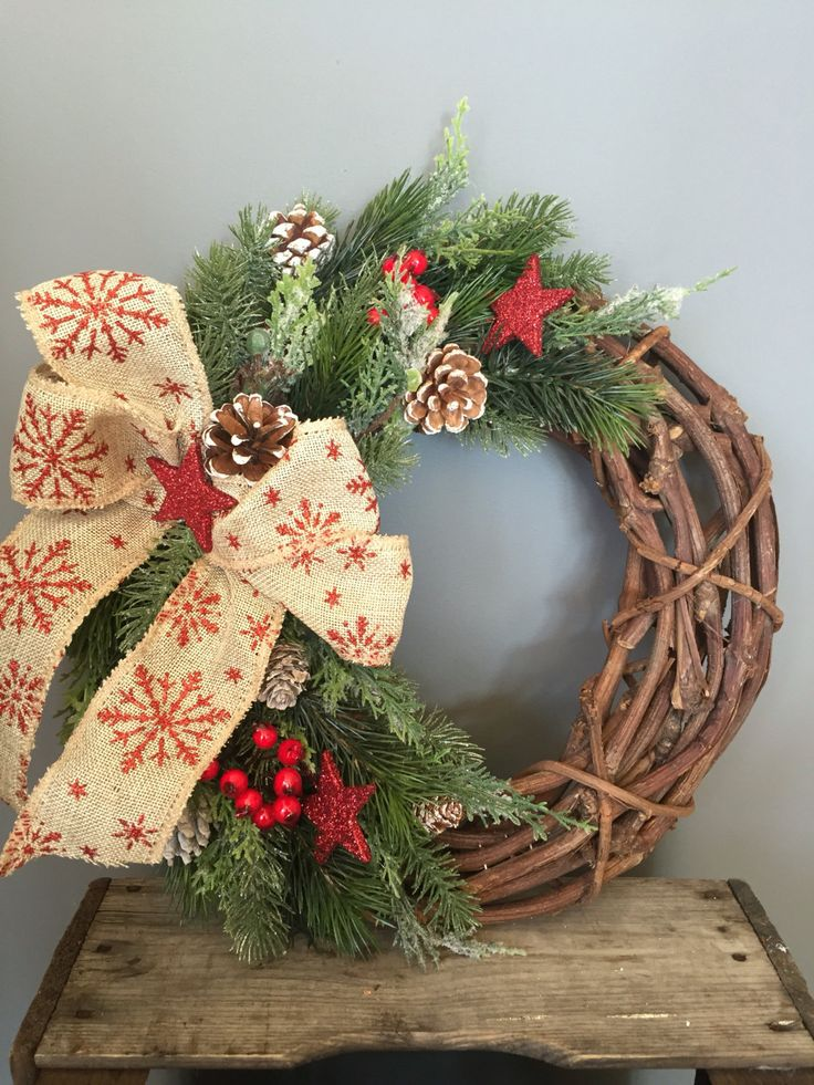 Rattan Christmas wreath with red glitter srats cones and