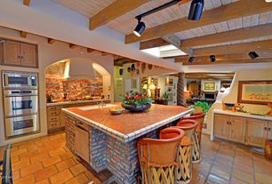 Southwestern Kitchen with Undermount Sink, Kitchen island, Exposed beam, Skylight, mexican tile backsplash, flush light