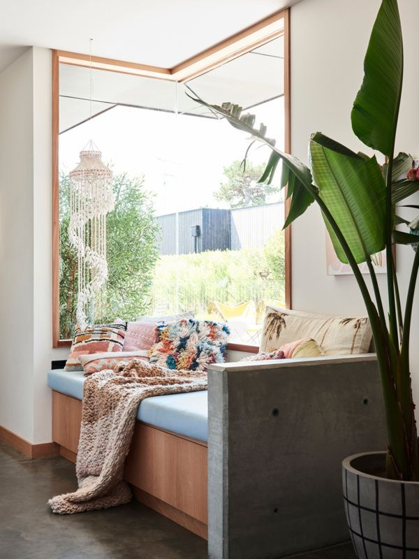 boho window seat nook with soft, fun colors and tropical plant