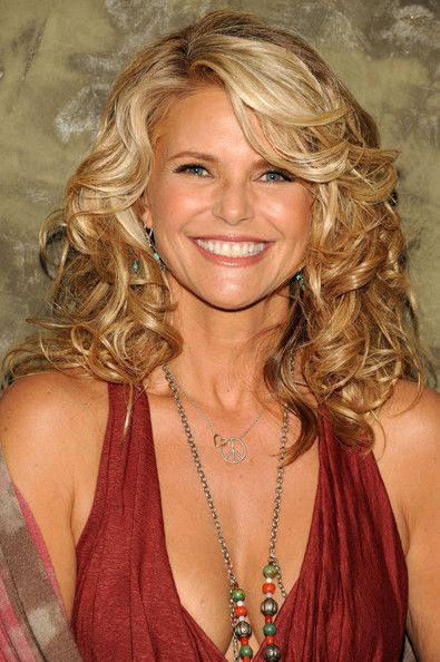 Christie Brinkley's Highlighted Curls - The supermodel rocks her honey-highlighted curls. (Hair Color Ideas)