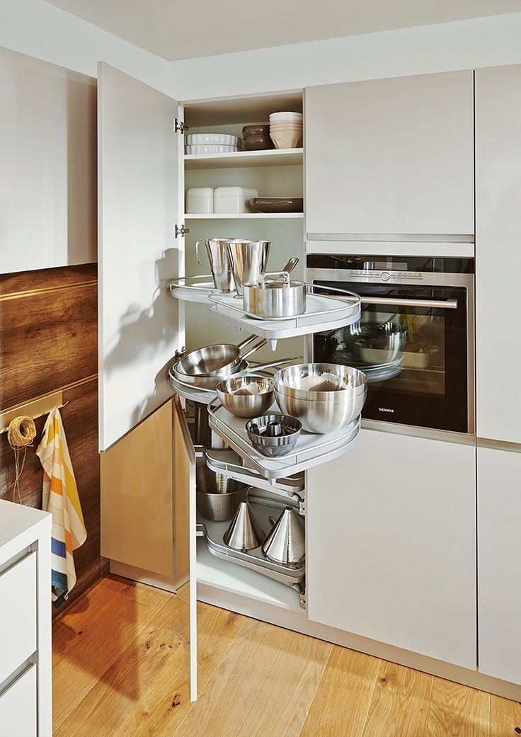 Make retrieving your pots and pans easy with the #Schuller Le Mans system | Fino Sand Grey High Gloss Kitchen Cupboards