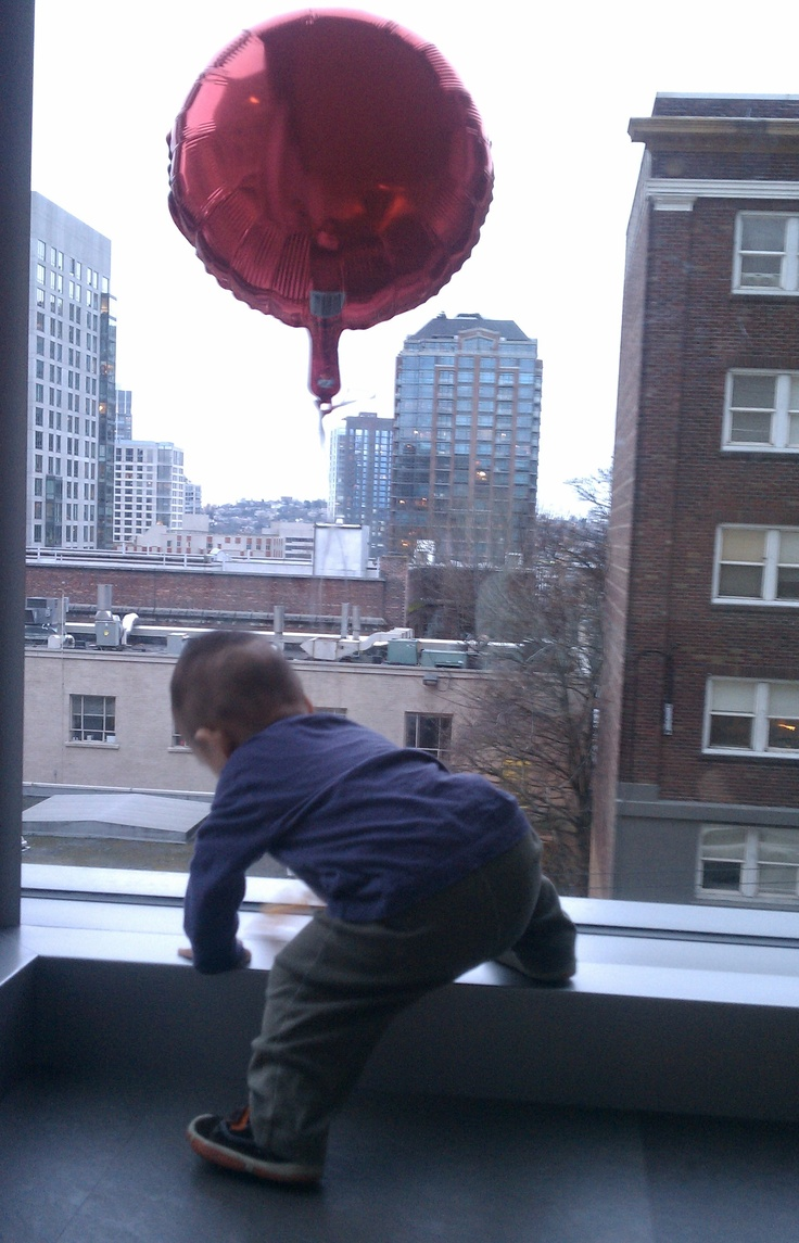 Exploring the world with his red balloon.