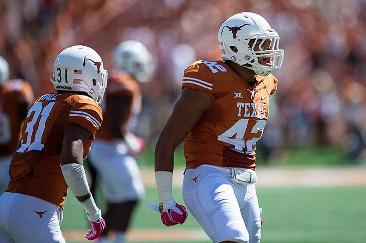 DE Caleb Bluiett (42) Texas football, Football helmets