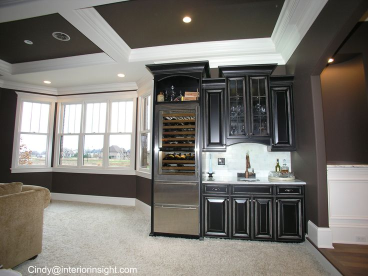 Wet bar with stainless wine and beer fridge black cabinets