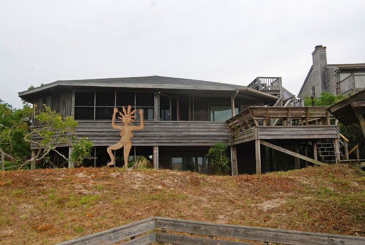 With unencumbered sunset and nature views over Bird Island Reserve, this end-of-island, classic Carolina family retreat rests on 2 very private acres. Try your hand at crabbing on the private pier or spinning family tall-tales, roasting marshmallows and stargazing beside the large fire pit nestled into the dunes. Contact us today to reserve your stay at Sunset Lodge! #sunsetbeach #beach #vacation