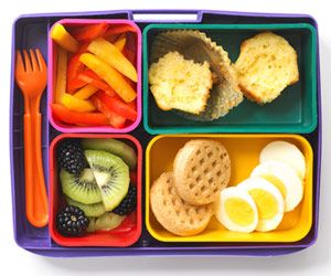 Early Riser - Love this idea for kids' bento boxes featuring a sliced hard-boiled egg and 2 mini whole-grain waffles along side   bell-pepper strips, sliced kiwi fruit and some blackberries. Rounding out this kids' bento lunch is a mini corn muffin. #kidsbento #bentolunch #lunchideas
