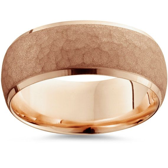Item #: WB4129RWidth: 7 mmWeight: 6.2 gMetal: 14k Rose Gold  This mens ring measures 7mm wide and features a brushed hammered center and polished