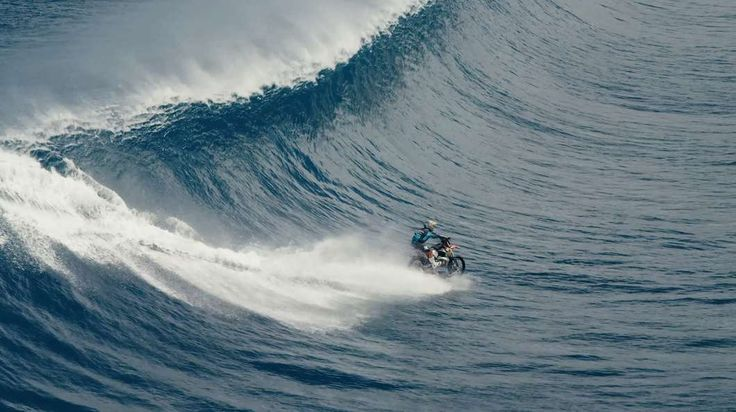Robbie Maddison drops into the beginning of a giant barrel wave on his KTM motorcycle