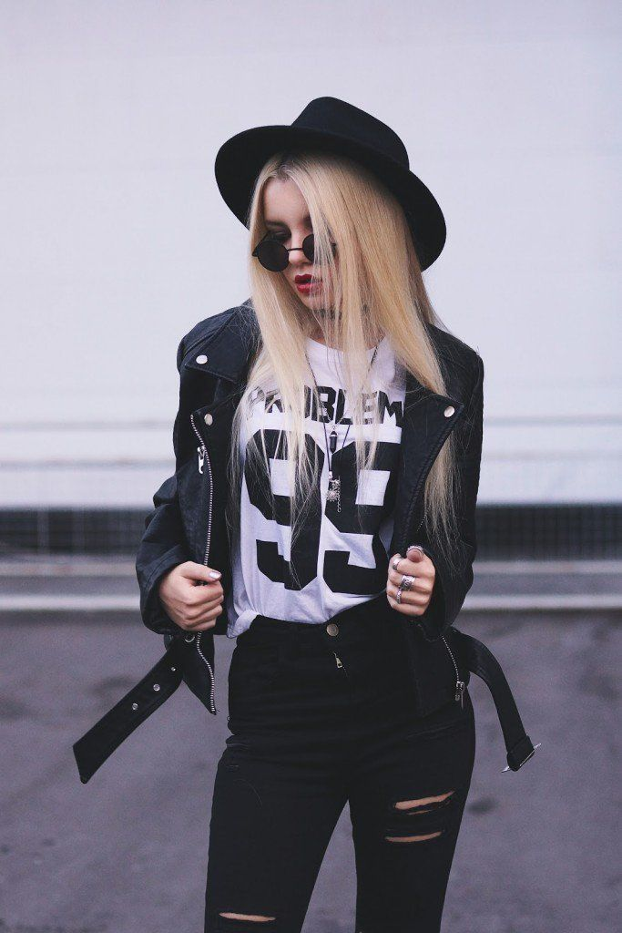 """Biker Jacket, Top """"99 Problems"""", Black Ripped Knee Jeans, Set of Rings, 3 Set of Chokers & Round Glasses - http://ninjacosmico.com/29-grunge-outfit-ideas-fall/"""